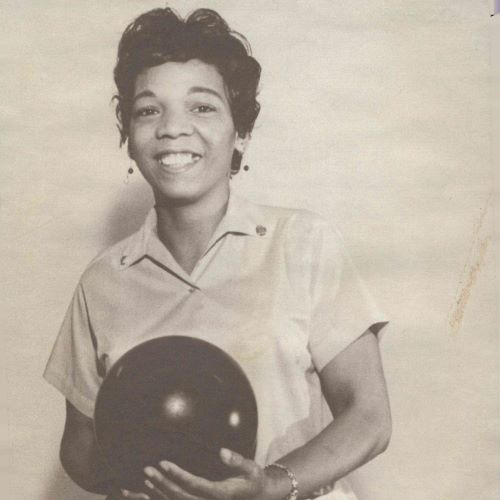 Earlene Fuller, smiles happily while holding her bowling ball. From the collection of Earlene Fuller bowling league photographs, 1963-1995.
