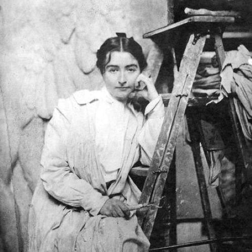Helen Farnsworth Mears sitting on a ladder and resting her head against her hand.