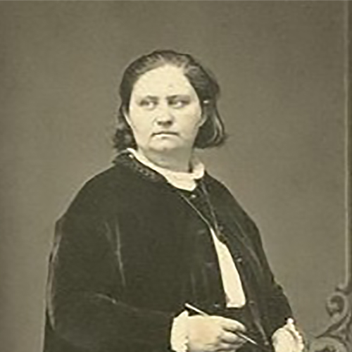 An austere woman stands facing to the right, but looking left. She holds writing implements and wears a long black robe.