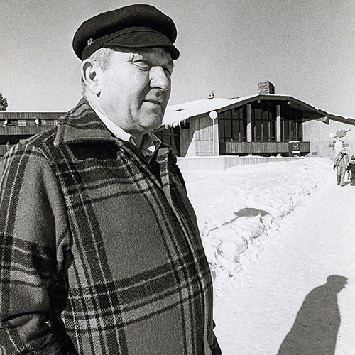 Hayward native Tony Wise shown in this undated photo in front of the Telemark Lodge looks off to the right away from the camera while wearing warm winter clothes for the snowy world around him. He's older, a bit rotund, with a slight squint and frown from the glare off the snow.