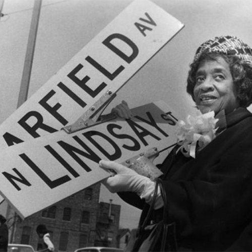 Bernice Lindsay Posing with the Street Sign Named after Her, 1974. Bernice worked as an activist and community leader in Milwaukee.