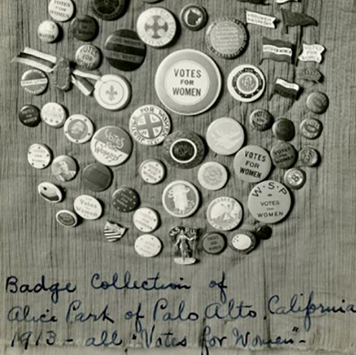 Several buttons are arranged in a circle, all with slogans, photographs, or symbols related to women's suffrage. Caption reads: Badge collection of Alice Park of Palo Alto, California, 1913 — all 'Votes for Women.'