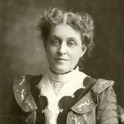 A black and white portrait photographic of Carrie Chapman