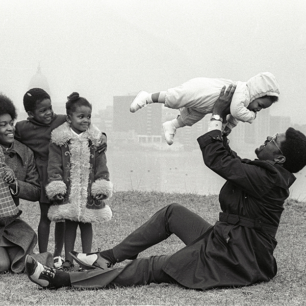 Eugene (Gene) Parks with his wife and children relaxing outdoors. From left to right are Kendra Parks, Marilyn Park, Wendy Parks, Stacey Parks, Reggie Parks (the baby) and Eugene Parks. Parks had a long career in Madison politics, often as a champion of civil rights issues. He was president of the local NAACP chapter from 1975-1979.