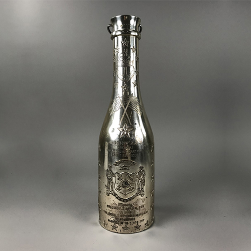 Silver champagne bottle holder from the launch of the battleship USS Wisconsin, 1943