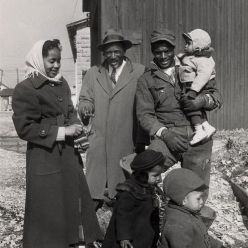 A Wisconsin family portrait outside, african american